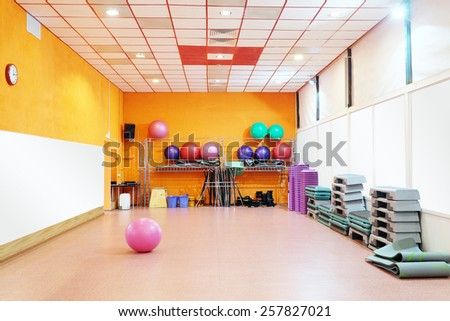 Interior of equipped gym at fitness center  - stock photo