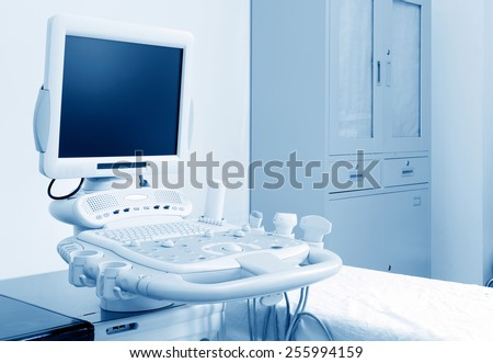 Interior of examination room with ultrasonography machine in hospital - stock photo