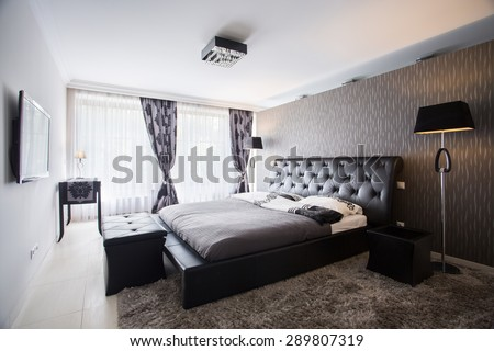 Interior of exclusive bedroom in luxury mansion - stock photo