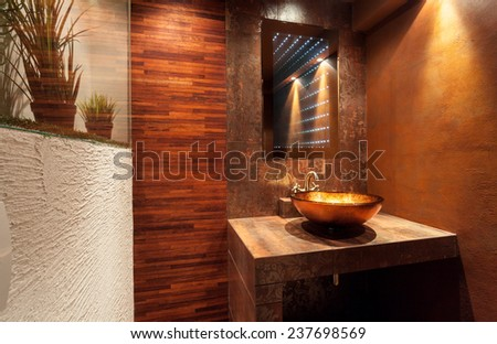 Interior of expensive bathroom with golden sink - stock photo