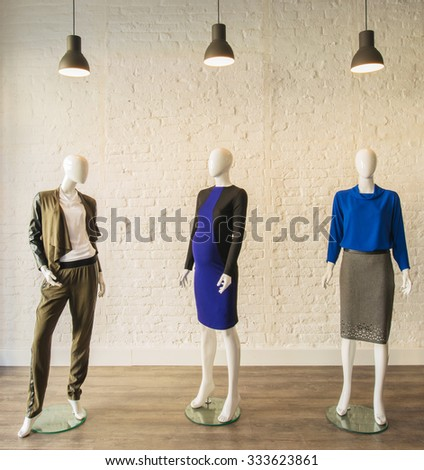 Interior of fashion clothing shop - stock photo