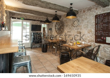 Interior of French bistro with rustic furniture. - stock photo