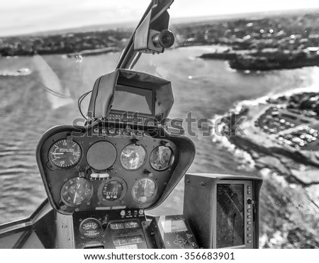 Interior of helicopter during flight. Cockpit and instruments. - stock photo