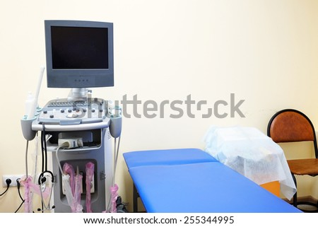 Interior of hospital room with ultrasound machine  - stock photo