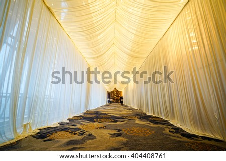 Interior of Hotel corridor for wedding set up with white gauze, romantic background. - stock photo