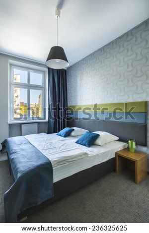 Interior of hotel room with double bed - stock photo