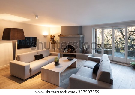 Interior of house, modern comfortable living room with fireplace - stock photo