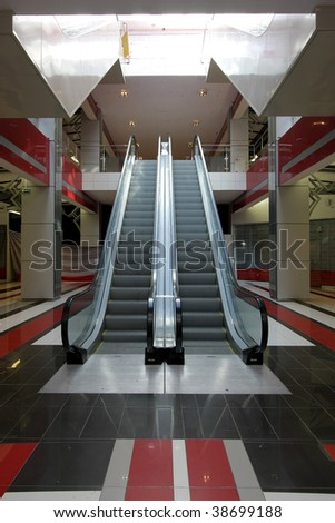 Interior of huge modern shopping centre - stock photo