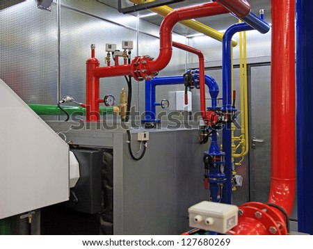 Interior of Independent  Boiler Room with manometers, valves,  pipelines - stock photo