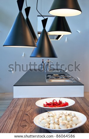 interior of  kitchen with modern lamps - stock photo