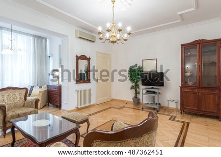 Interior of living room with classic style furniture