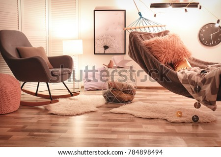 Interior Of Living Room With Comfortable Armchair And Hammock