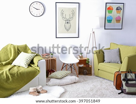 Interior of living room with green armchair and couch - stock photo