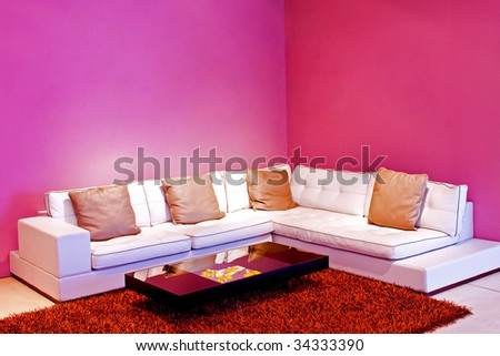 Interior of living room with purple walls - stock photo