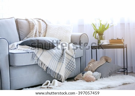 Interior of living room with sofa and small table - stock photo