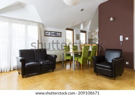 Interior of loft apartment living room - stock photo