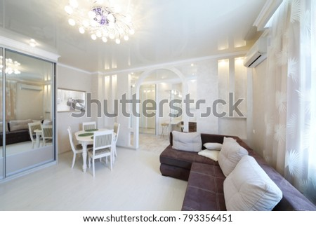 Interior of luxurious living room with table, sofa in apartment