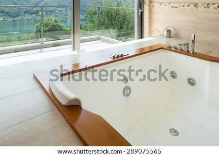 Interior of  luxury apartment furnished, comfortable bathroom with jacuzzi - stock photo
