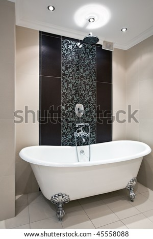Interior of luxury bathroom with expensive bath and shower - stock photo