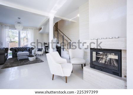 Interior of luxury living room with fireplace - stock photo
