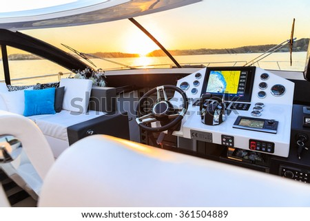 interior of luxury motoryacht at sunset - stock photo