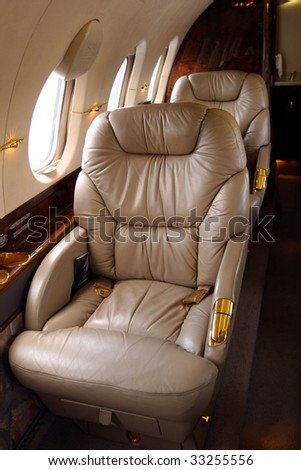 Interior of luxury private jet - stock photo