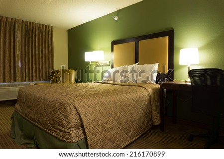Interior of luxury single bed in hotel bedroom - stock photo