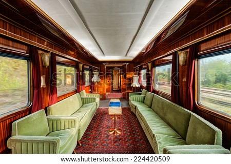interior of luxury vinitage old train carriage from 1950 - stock photo