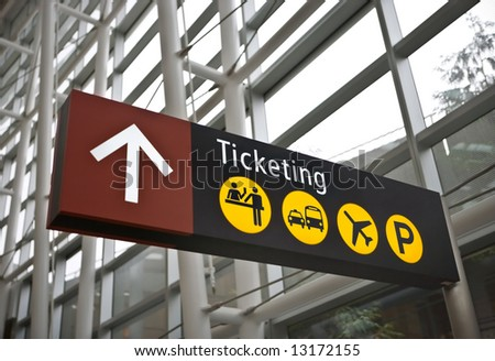 Interior of main terminal at Sea-Tac (Seattle) airport with closeup of ticketing direction sign - stock photo