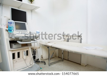 Interior of medical room with ultrasound machine in hospital - stock photo