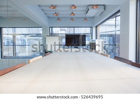 Interior of meeting room in modern office at city scape.
