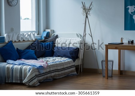 Interior of messy room of single man - stock photo