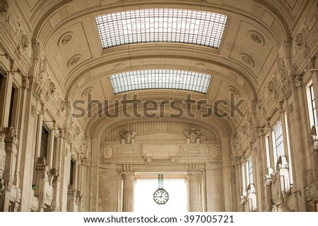Interior of Milano Centrale which is the main railway station of Milan, Italy, and one of the main railway stations in Europe. - stock photo