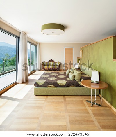 Interior of modern apartment furnished, comfortable bedroom - stock photo