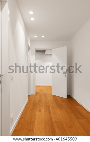 Interior of modern apartment with wooden floor - stock photo