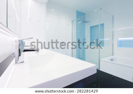 interior of modern bathroom in blue and white color combination - stock photo