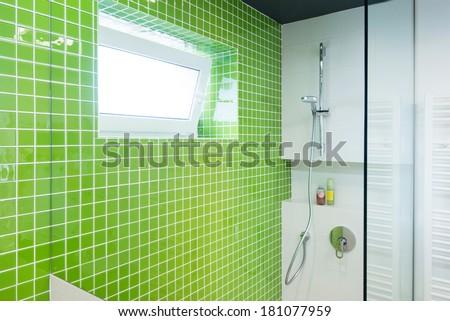 interior of modern bathroom with green tiles - stock photo