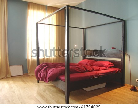 interior of modern bedroom with big bed - stock photo