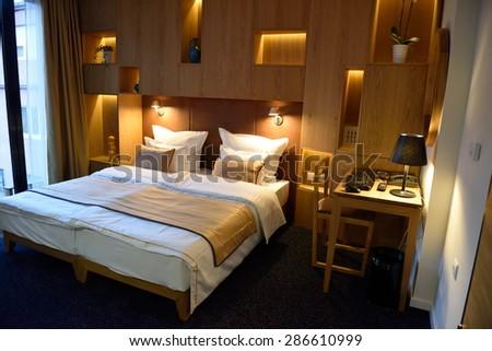 Interior of modern comfortable hotel room - stock photo