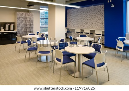 Interior of modern company lunchroom where employees can have their break. - stock photo