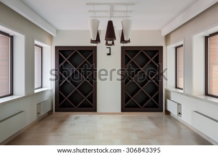 Interior of modern empty space with empty closet and windows - stock photo