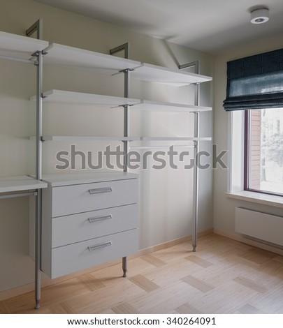 Interior of modern empty wardrobe room with window  - stock photo