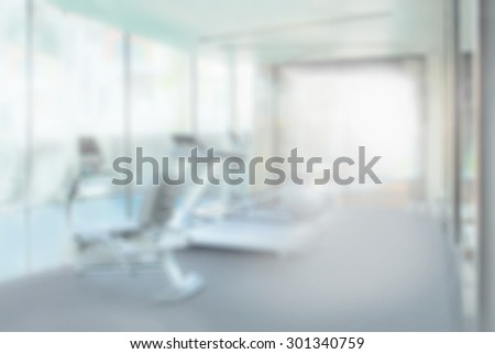 interior of modern fitness center gym with equipment, abstract blur background - stock photo