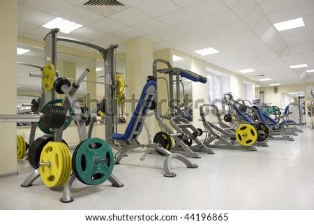 Interior of modern fitness gym - stock photo