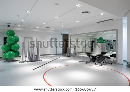 Interior of modern health and fitness club