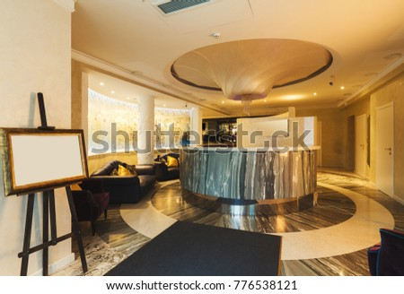 Interior of modern hotel. Luxury reception desk in contemporary style, copy space