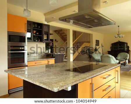 Interior of modern house: kitchen and dining room - stock photo