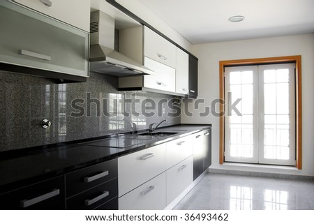 Interior of modern kitchen in a new apartment - stock photo
