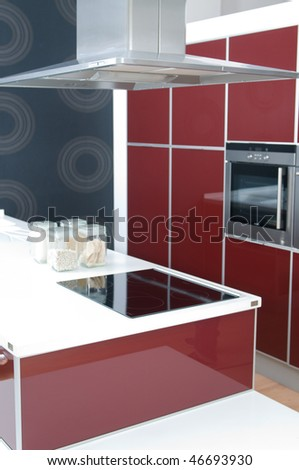 interior of modern kitchen with oven in red tones - stock photo