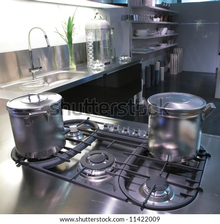 interior of modern kitchen with steel saucepan